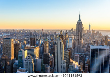 New York City - USA. View to Lower Manhattan downtown skyline with famous Empire State Building and skyscrapers at sunset. stock photo
