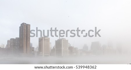 New York City waterfront cityscape in fog. #539948362