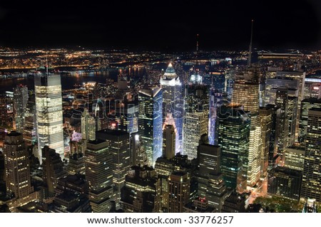 New York City, with Times Square illuminating the surrounding buildings.