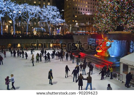 NEW YORK-DEC 2: Ice skaters and tourists are all around the famous Rockefeller Center Christmas tree on December 2, 2011.