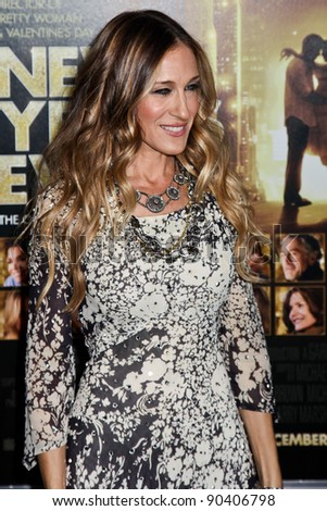 NEW YORK  - DECEMBER 07: Actress Sarah Jessica Parker poses for a photo during the 'New Year's Eve' premiere at Ziegfeld Theatre on December 7, 2011 in New York City.