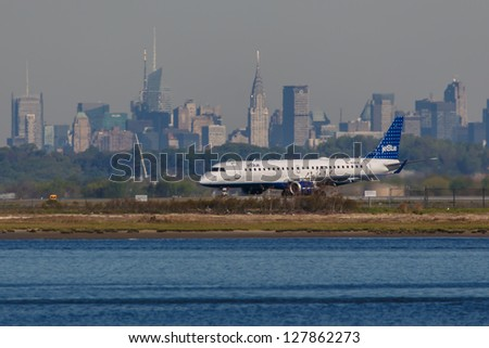 NEW YORK - DECEMBER 9: Airbus A320 JetBlue lining up on JFK in New York USA on December 9, 2012 The A320 was the first narrow body airliner from Airbus It is the biggest competition to Boeing 737NG