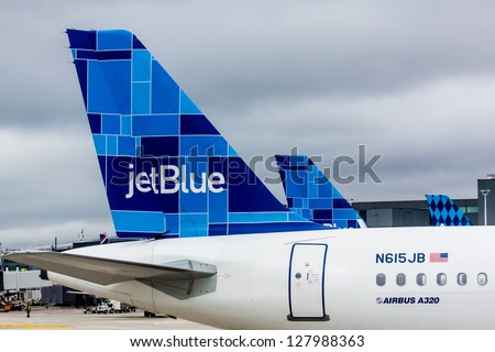 NEW YORK - DECEMBER 9: Airbus A320 JetBlue tailfin Mosaic design on JFK airport in New York, USA on December 9, 2012 JetBlue aircrafts feature one of several tail designs and a name with the word blue