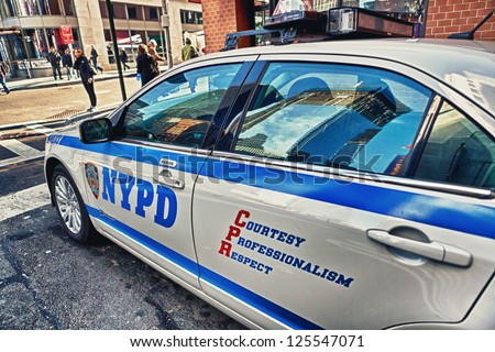 NEW YORK - DECEMBER 9: New York City Police Department car in New York City on December 9, 2012. NYPD is one of the oldest police departments and the largest municipal police force in United States. - stock photo
