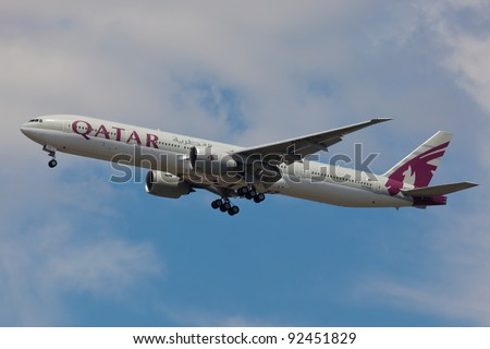 """NEW YORK - DECEMBER 21: Qatar Boeing 767 on final to JFK in New York, USA on December 6, 2011. Qatart is rated top 3 best airlines in the world also rated the as a """"best food in flight"""" in the world"""