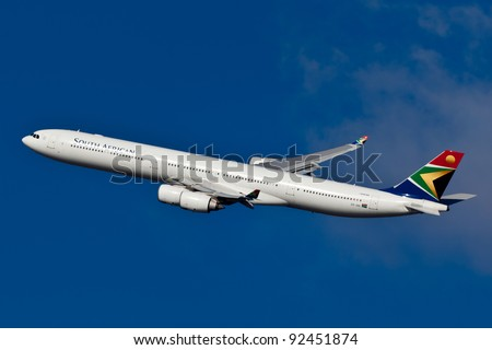 NEW YORK - DECEMBER 21: SAA A340 climbs after take off from JFK airport located in New Yokr, USA on December 21, 2011 South African Airways is national flag carrier and largest airline of South Africa