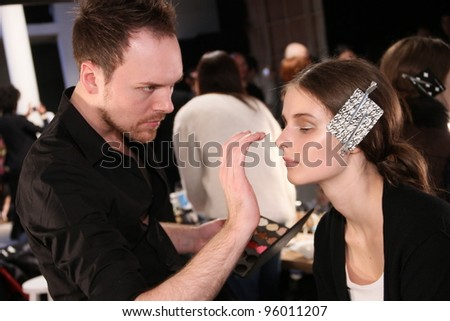 NEW YORK - FEBRUARY 10: A Model gets ready for Tess Giberson Fall/Winter 2012 presentation in Lincoln Center during New York Fashion Week on February 10, 2012 in NYC. #96011207