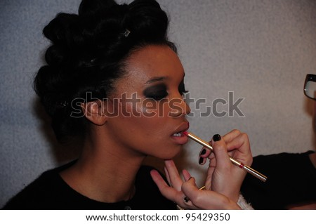 NEW YORK - FEBRUARY 16: A Model getting ready for Stephen Burrows Fall/Winter 2012 presentation at Audi Forum during New York Fashion Week on February 16, 2012 in NYC. - stock photo