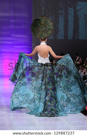 NEW YORK - FEBRUARY 15:  A Model walks on the Catalin Botezatu fashion runway at The New Yorker Hotel during Couture Fashion Week on February 15, 2013 in New York City - stock photo