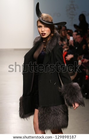 """NEW YORK - FEBRUARY 13: A model walks the runway at Adolfo Sanchez Fall Winter 2013 collection """"Alar"""" during Nolcha Fashion Week on February 13, 2013 in New York City."""