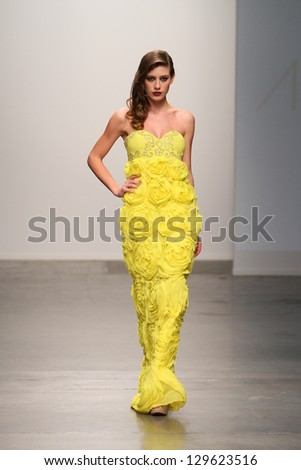 NEW YORK - FEBRUARY 13: A model walks the runway at Andressa Leao Fall Winter 2013 Collection during Nolcha Fashion Week on February 13, 2013 in New York City.