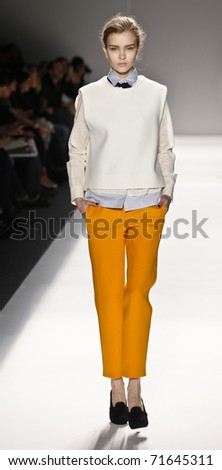NEW YORK - FEBRUARY 16: A model walks the runway for collection by Yigal Azrouel at Mercedes-Benz Fall/Winter 2011 Fashion Week on February 16, 2011 in New York City. - stock photo