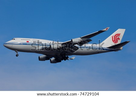 NEW YORK - FEBRUARY 10: Boeing 747-400 China Air approaching JFK airport located in New York, USA on February10, 2011. B747 called Jumbo Jet is most popular plane used in cargo and passenger transport