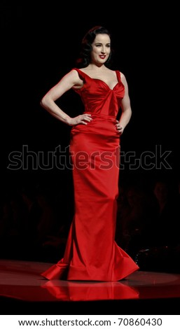 NEW YORK - FEBRUARY 09: Dita Von Teese in Zac Posen dress walks runway for The Heart Truth's Red Dress Collection at Mercedes-Benz Fall/Winter 2011 Fashion Week on February 09, 2011 in New York City.