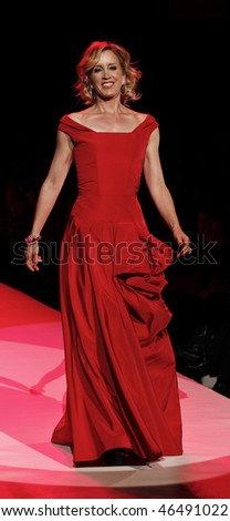 NEW YORK - FEBRUARY 11: Felicity Hoffman walks the runway [dress by Oscar de la Renta] at the Heart Truth's Red Dress Collection for Fall 2010 during Mercedes-Benz Fashion Week on Feb 11, 2010 in NYC