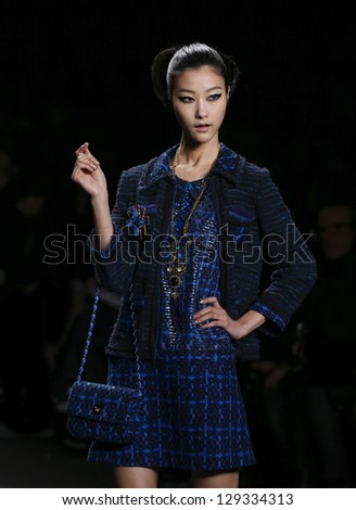 NEW YORK - FEBRUARY 13: Model walks runway during Fall/Winter 2013 presentation for Anna Sui collection at Mercedes-Benz Fashion Week at Lincoln Center on February 13, 2013 in New York