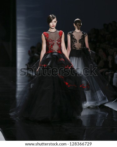 NEW YORK - FEBRUARY 11: Model walks runway during Fall/Winter 2013 presentation for Reem Acra collection at Mercedes-Benz Fashion Week at Lincoln Center on February 11, 2013 in New York
