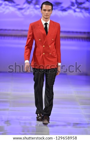 NEW YORK - FEBRUARY 17: Model walks runway for Allex Kangala collection at New Yorkek Hotel during Couture Fashion Week on February 17, 2013 in New York City