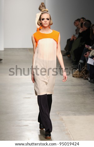NEW YORK - FEBRUARY 12: Model walks the runway at the A Detacher FW 2012 Collection presentation during Mercedes-Benz Fashion Week on February 12, 2012 in New York.