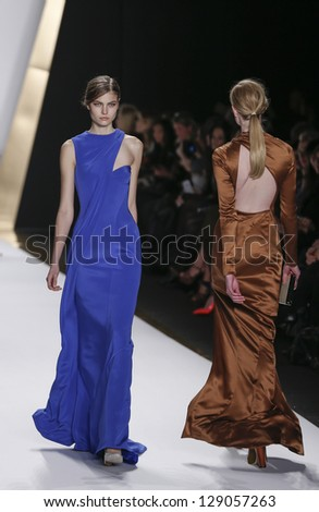 NEW YORK - FEBRUARY 13: Models walk runway during Fall/Winter 2013 presentation for J. Mendel collection at Mercedes-Benz Fashion Week at Lincoln Center on February 13, 2013 in New York