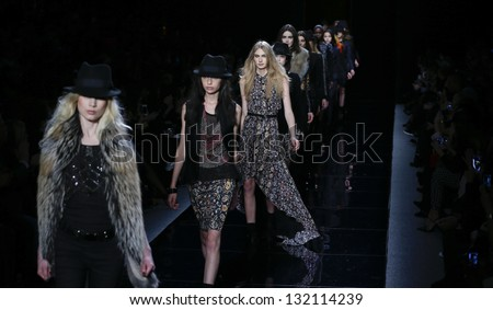 NEW YORK - FEBRUARY 08: Models walk runway for collection by Nicole Miller during Fall/Winter 2013 at Mercedes-Benz Fashion Week at Lincoln Center on February 8, 2013 in New York