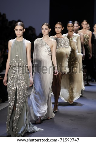 NEW YORK - FEBRUARY 17: Models walk the runway for collection by Naeem Khan at Mercedes-Benz Fall/Winter 2011 Fashion Week on February 17, 2011 in New York City.