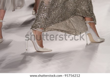 NEW YORK - FEBRUARY 15: Models walks runway for J. Mendel Fall/Winter 2012 presentation in Lincoln Center during New York Fashion Week on February 15, 2012 in NYC. - stock photo
