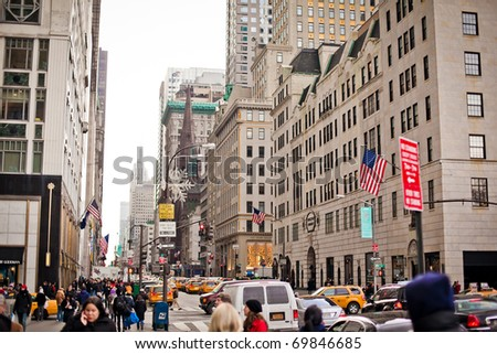NEW YORK - JAN 6: City streetlife in point of intersection of 5th Av. and 58th st. near  Central Park on January 6, 2011 in Manhattan, New York City - stock photo
