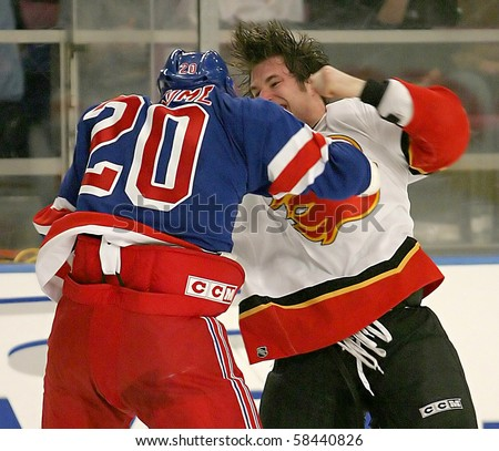 NEW YORK - JAN 05: Pascal Rheaume of the New York Rangers in action against Steve Montador of the Calgary Flames Jan 05, 2004 in NY,NY.