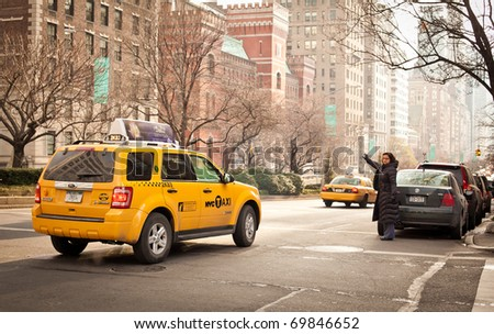 NEW YORK - JAN 6: Woman catches a taxi on Madison Avenue on January 6, 2011 in Manhattan, New York City