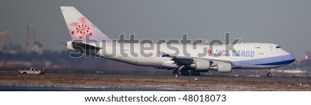 NEW YORK - JANUARY 6: A Boeing 747 cargo plane, China Airlines Cargo departs from JFK Airport Runway 4L on January 6, 2010 in New York.