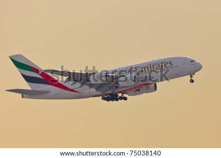 NEW YORK - JANUARY 2: A38 Emirates approaching JFK airport in New York, USA on January 2, 2011. A380 as of 2011 is the biggest commercial airplane and the newest plane built by Airbus company