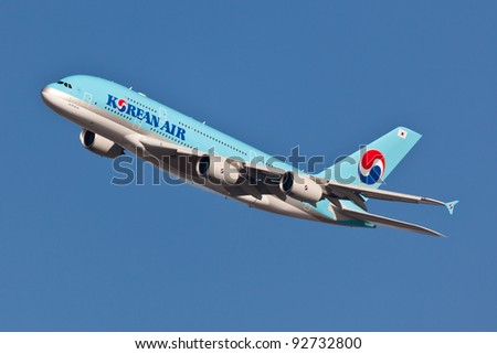 NEW YORK - JANUARY 2:A380 Korean Air climbs after takeoff for JFK in New York, USA on January 2, 2012 Blue top livery was introduced on in 1984 A380 is the biggest passenger plane in the world