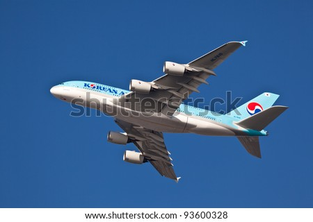 NEW YORK - JANUARY 21:A380 Korean Air climbs after takeoff for JFK in New York, USA on January 21, 2011Blue top livery was introduced on in 1984 A380 is the biggest passenger plane in the world