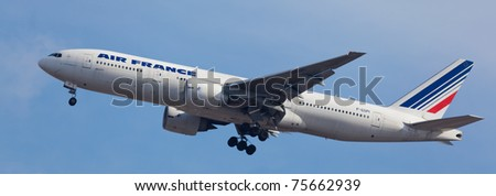 NEW YORK - JANUARY 12: Boeing 777 Air France arrives at JFK in New York, USA on January 12, 2011. Air France is the biggest airline in Europe. Air France is rated top10 best airlines in the world