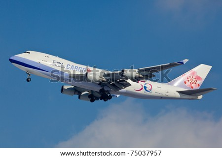 NEW YORK - JANUARY 28: Boeing 747 China Airline climbs from JFK airport in New York, USA on January 28, 2011. is the flag carrier of the Republic of China - commonly known as Taiwan