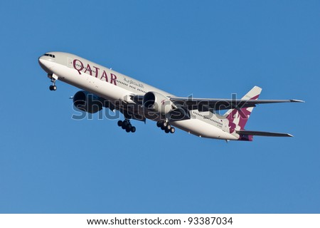 NEW YORK - JANUARY 5:Boeing 777 Qatar on final approach to JFK in New York, USA on JANUARY 5, 2012 Qatar Airline is rated 3rd best airlines in the world Qatar airline is flag carrier airline of Qatar