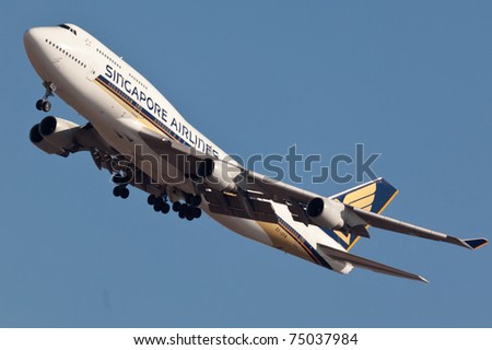 NEW YORK - JANUARY 15: Boeing 747 Singapore Airlines approaching JFK in New York, USA on January 15, 2011. 747-400 most popular cargo plane used by commercial airlines Her nickname: Queen of the sky
