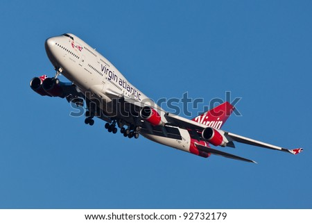 NEW YORK - JANUARY 2: Boeing 747 Virgin Atlantic approaches JFK Airport in New York on January 2, 2012 Plane is wearing new livery announced in early 2011 Boeing 747 is popularly called Jumbo Jet - stock photo