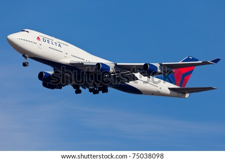 NEW YORK - JANUARY 2: Delta Boeing 747 on approach to JFK in New York, USA on January 2, 2011. Delta Air Lines is one of the major American airline that serves domestic and international destinations