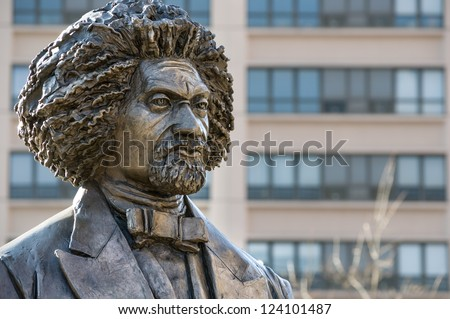 NEW YORK - JANUARY 6, 2013: Frederick Douglass statue on January 6, 2013 in Harlem, New York. Frederick Douglass was an African-American social reformer, orator, writer and statesman. - stock photo