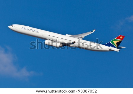 NEW YORK - JANUARY 7: SAA A340 climbs after take off from JFK airport located in New York, USA on January 7, 2012 South African Airways is national flag carrier and largest airline of South Africa - stock photo