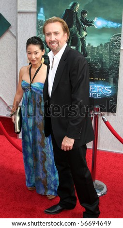 "NEW YORK - JULY 6: Actor Nicolas Cage and his wife, Alice Kim, attend the premiere of ""The Sorcerer's Apprentice"" at the New Amsterdam Theatre on July 6, 2010 in New York City."