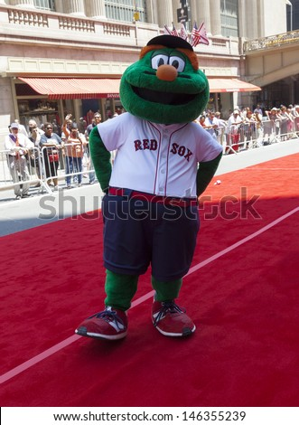 NEW YORK - JULY 16: Boston Red Sox Wally the Green Monster poses on red carpet during the MLB All-Star Game Red Carpet Show along 42nd street on July 16, 2013 in New York