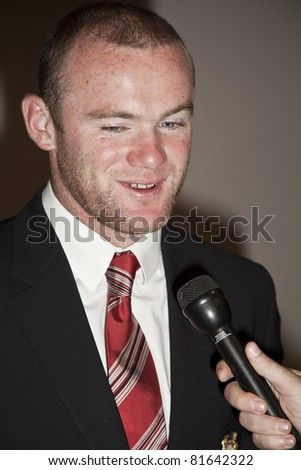 NEW YORK - JULY 25: Footballer Wayne Rooney attends Hublot 'Art of Fusion' fashion show with Sir Alex Ferguson & Manchester United at Cipriani, Wall Street on July 25, 2011 in New York City