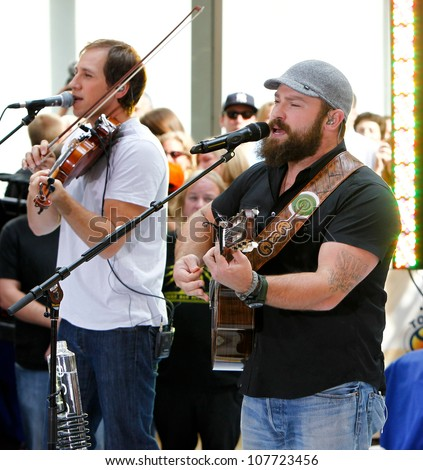 NEW YORK-JULY 13: Jimmy De Martini (left) and Zac Brown perform on the Today Show at Rockefeller Plaza on July 13, 2012 in New York City.