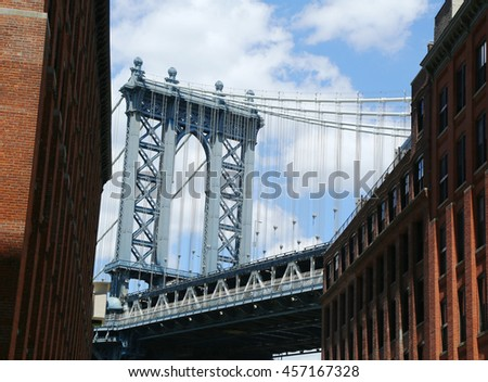 NEW YORK - JULY 21, 2016: Manhattan Bridge view. The Manhattan Bridge is a suspension bridge that crosses the East River, it was opened on December 31, 1909 and was designed by Leon Moisseiff  #457167328