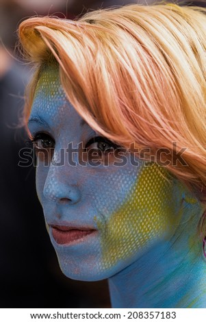 NEW YORK - JULY 26: Nude models, artists take to New York City streets during first official Body Painting Event featuring artist Andy Golub on July 26, 2014 in New York NY