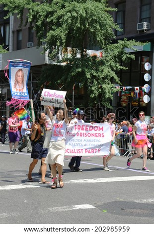 NEW YORK - June 29, 2014: Amnesty International group demanding freedom for Chelsea Manning (born Bradley Manning) during  LGBT Pride Parade  in New York City on June 29, 2014.