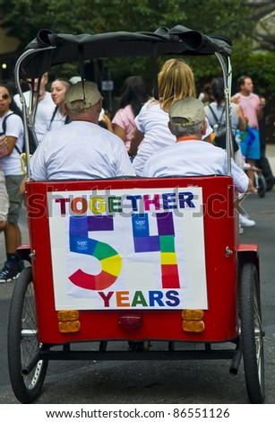 NEW YORK -  JUNE 26 : An unidentified old gay couple celebrate in a gay pride parade after passing the same sex marriage bill in New York City on June 26, 2011.